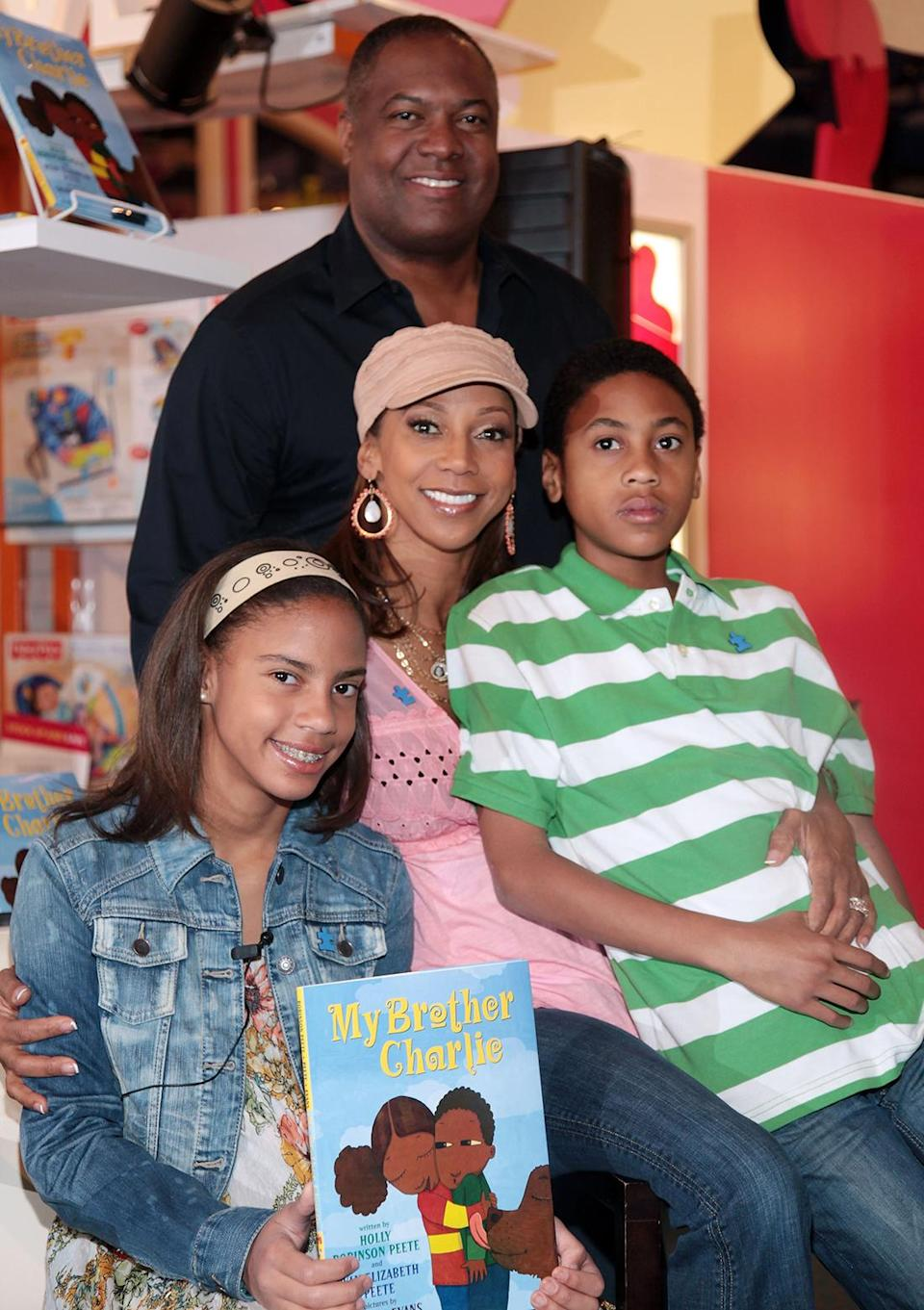 """Ryan Elizabeth Peete, Holly Robinson Peete, Rodney Peete, and Rodney Jackson """"R.J."""" Peete promote """"My Brother Charlie"""" and """"Not My Boy"""" at Toys """"R"""" Us on April 3, 2010, in New York City. (Photo by Astrid Stawiarz/Getty Images)"""