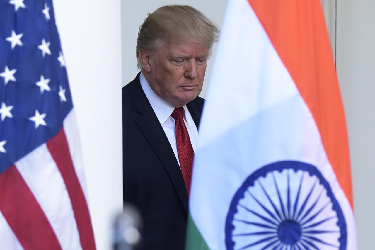 President Donald Trump walks out from the Oval Office to make a joint statement with Indian Prime Minister Narendra Modi in the Rose Garden of the White House in Washington, Monday, June 26, 2017. (AP Photo/Susan Walsh)