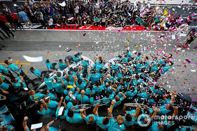 """Mercedes AMG F1 team celebrate during team photograph <span class=""""copyright"""">Steven Tee / Motorsport Images</span>"""