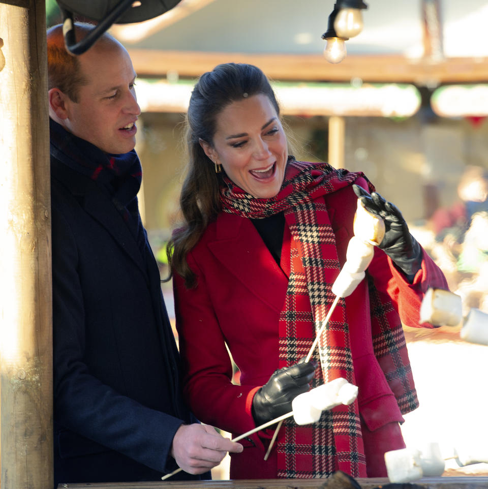 CARDIFF, WALES - DECEMBER 08: Prince William, Duke of Cambridge and Catherine, Duchess of Cambridge toast marshmallows during a visit to Cardiff Castle to meet local university students and hear about some of the challenges they have experienced during the pandemic, with a particular focus on mental health on December 08, 2020 in Cardiff, Wales. The Duke and Duchess are undertaking a short tour of the UK ahead of the Christmas holidays to pay tribute to the inspiring work of individuals, organizations and initiatives across the country that have gone above and beyond to support their local communities this year. (Photo by Jonathan Buckmaster - Pool / Getty Images)