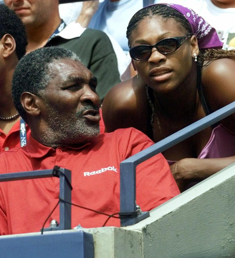 """FILE - In this Aug. 30, 2000, file photo, Richard Williams, the father and coach of United States' Venus Williams, of Palm Beach Gardens, Fla., speaks with daughter Serena during Venus' match against the Czech Republic's Kveta Hrdlickova at the U.S. Open tennis tournament in New York. His new book, """"Black and White: The Way I See It,"""" comes out May 6. It goes into detail about how Indian Wells, as he writes, """"disgraced America."""" (AP Photo/Suzanne Plunkett, File)"""