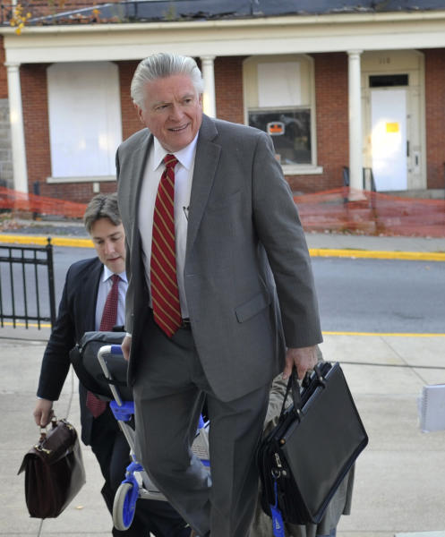 Tom Scott, attorney for the NCAA, enters the Centre County Courthouse, Tuesday, Oct. 29, 2013, in Bellefonte, Pa., for a court hearing. Lawyers for the NCAA, the Paterno family and Paterno supporters were at the Centre County Courthouse, Tuesday for a court hearing on whether to allow a lawsuit filed against the NCAA by the family of longtime Penn State football coach Joe Paterno and others to go forward. The lawsuit brought by the Paterno family aims to wipe out the NCAA sanctions against Penn State University. (AP Photo/Centre Daily Times, Nabil K. Mark) MAGS OUT MANDATORY CREDIT