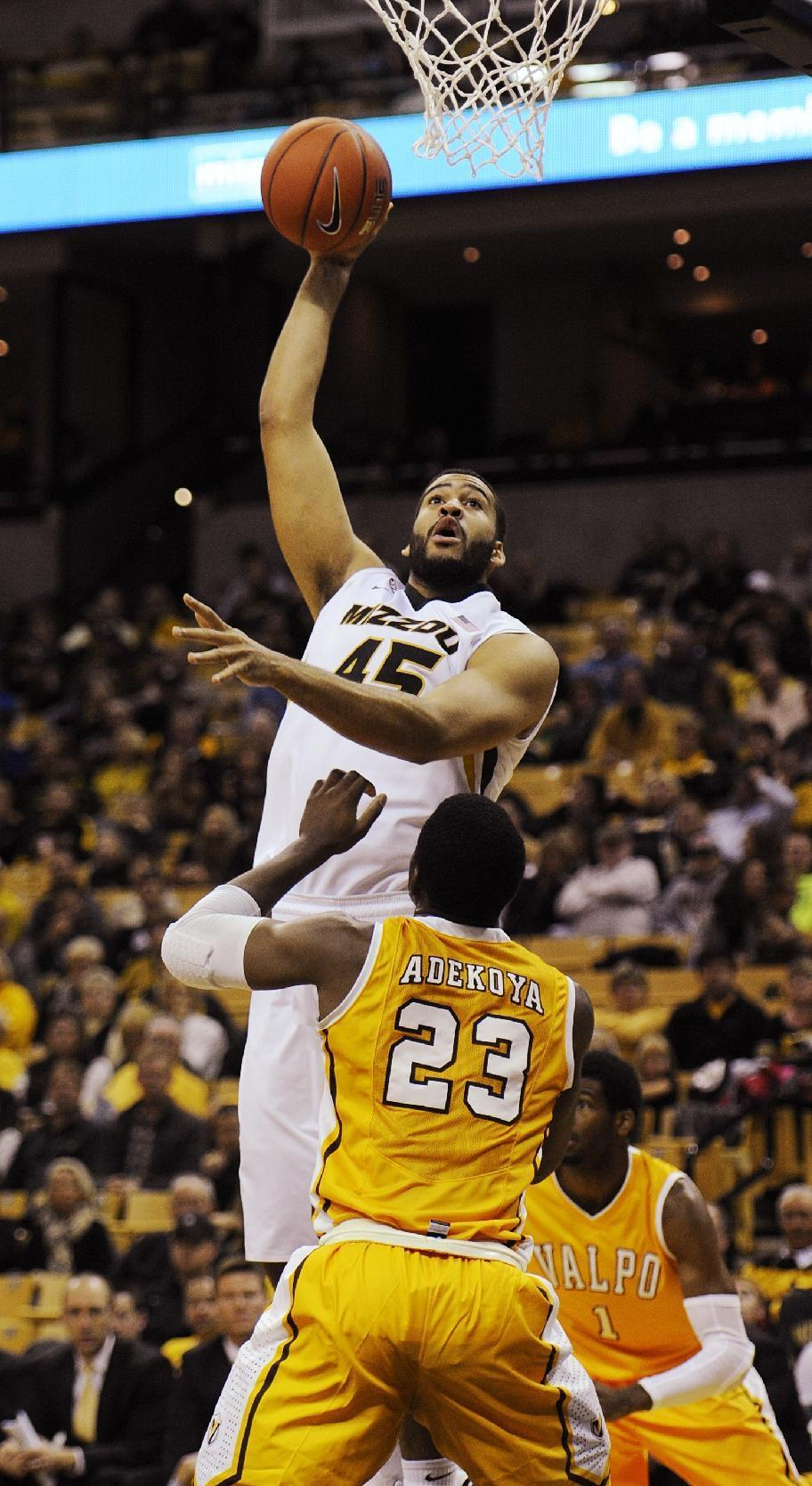 Missouri's Keanau Post, top, shoots over Valparaiso's Jubril Adekoya, bottom, during the first half of an NCAA college basketball game Sunday, Nov. 16, 2014, in Columbia, Mo. (AP Photo/L.G. Patterson)