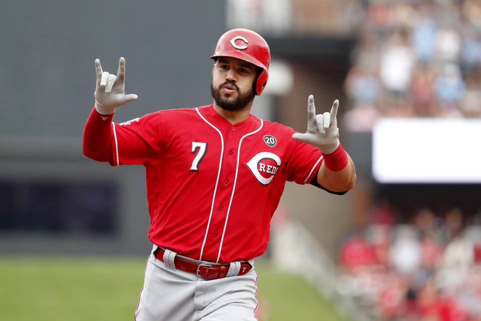 Cincinnati Reds' Eugenio Suarez celebrates as he rounds the bases after hitting a two-run home run during the third inning in the first baseball game of a doubleheader against the St. Louis Cardinals, Sunday, Sept. 1, 2019, in St. Louis. (AP Photo/Jeff Roberson)