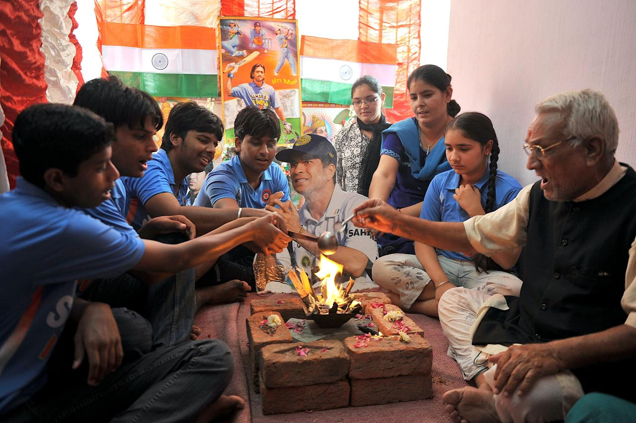 Indian cricket fans offer special prayers for their team to win the Cricket World Cup, especiallly for Sachin Tendulkar (cardboard cut out), in Hyderabad on March 5, 2011. Many Cricket fans offer special prayers for the Indian team and especially for their star player Sachin Tendulkar. AFP PHOTO / Noah SEELAM (Photo credit should read NOAH SEELAM/AFP/Getty Images)