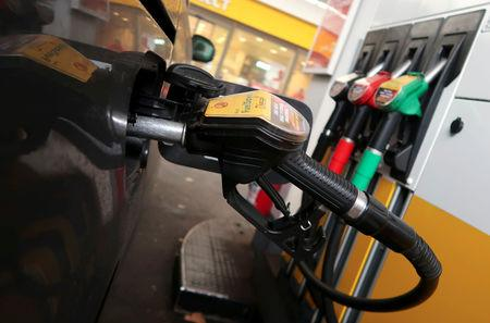 FILE PHOTO: A diesel fuel nozzle is seen attached to a car at a Shell petrol station in Berlin, Germany October 22, 2018.    REUTERS/Fabrizio Bensch/File Photo