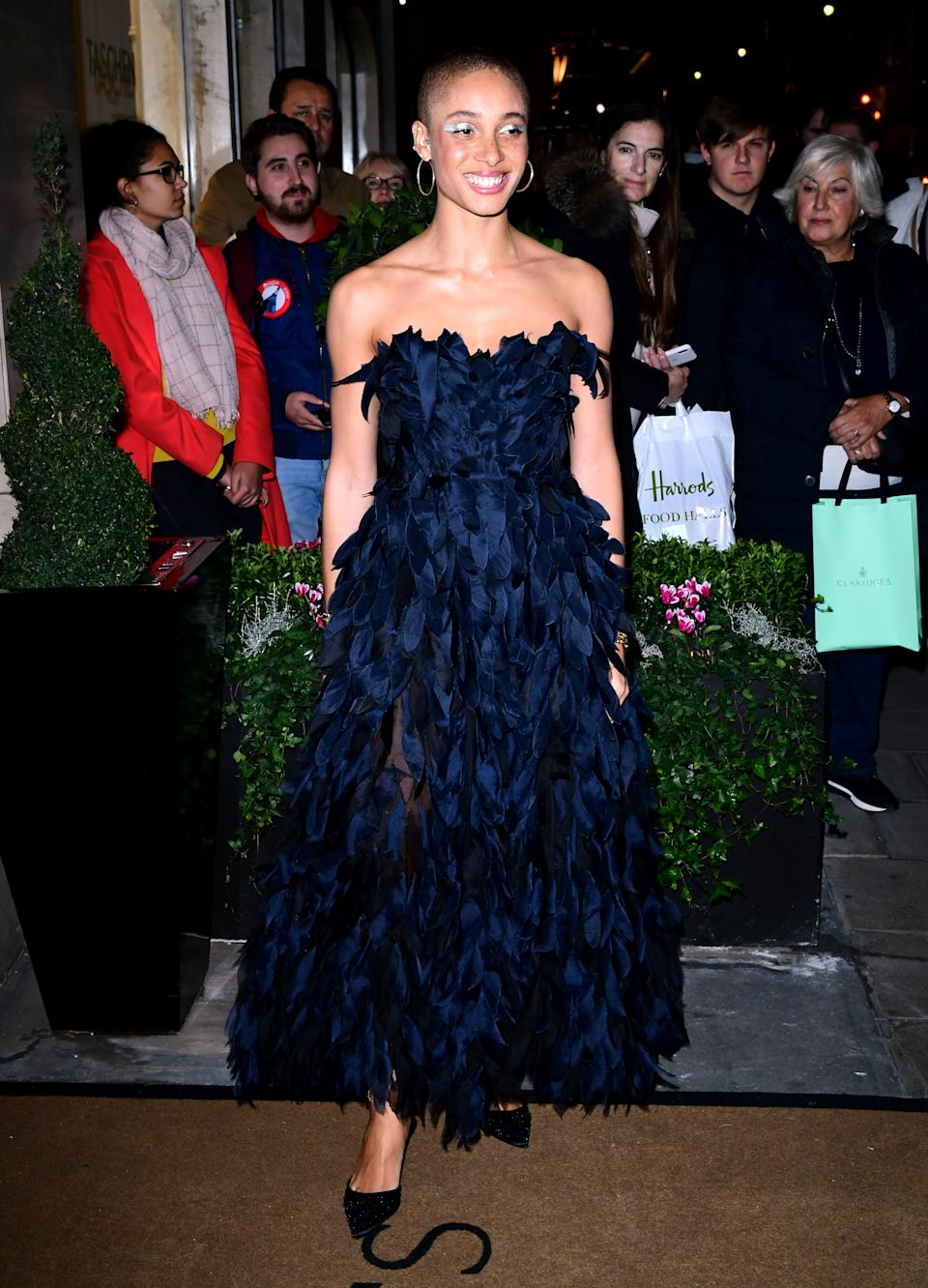 The model stunned in a texture black gown. [Photo: Getty]
