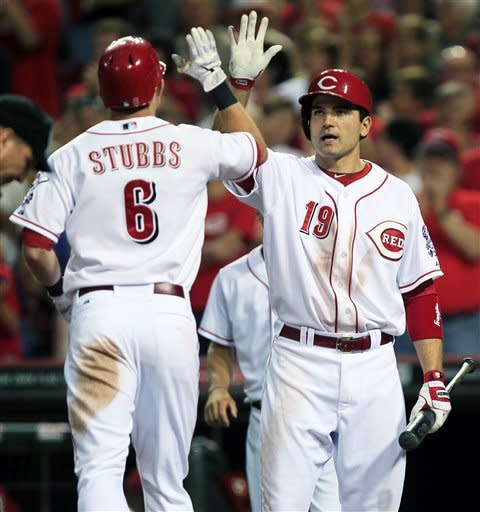 Cincinnati Reds' Drew Stubbs (6) is congratulated by Joey Votto (19) after Stubbs hit a solo home run in the eighth inning of a baseball game against the Milwaukee Brewers, Tuesday, June 26, 2012, in Cincinnati. Cincinnati won 4-3. (AP Photo/Al Behrman)