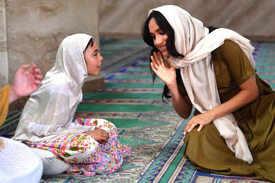 <p>A number of stunning photos came out of Meghan and Harry's royal tour of southern Africa, like this one of the Duchess in Bo Kaap, where she visited Auwal Mosque.</p>