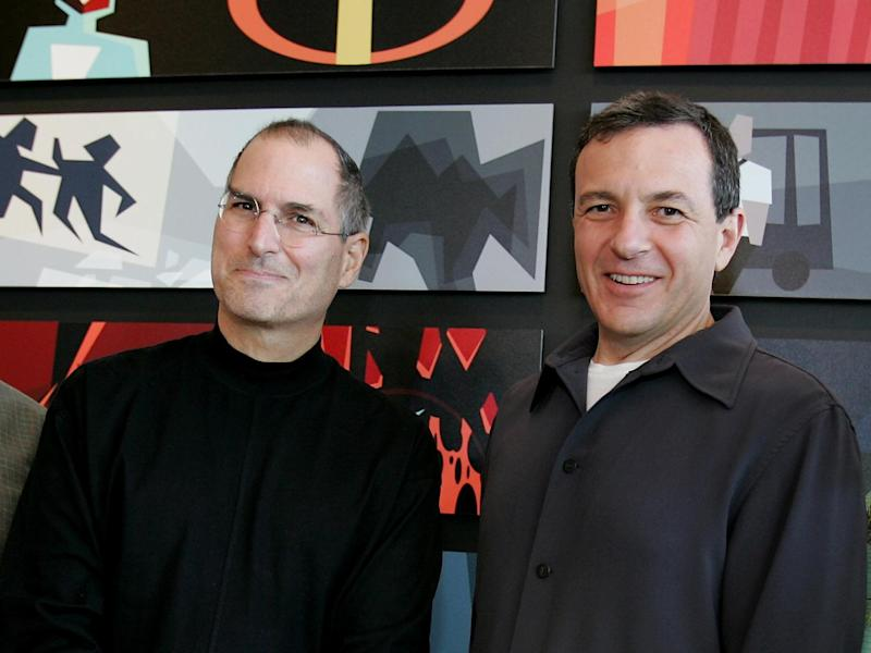 Steve Jobs, as Pixar Animation Studios CEO with Walt Disney CEO Robert Iger (l-r), after announcement that Disney is buying Pixar, photo