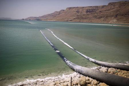 Pipes that pump water cross through evaporation pools, which today make up the southern part of the Dead Sea, Israel July 27, 2015. REUTERS/Amir Cohen