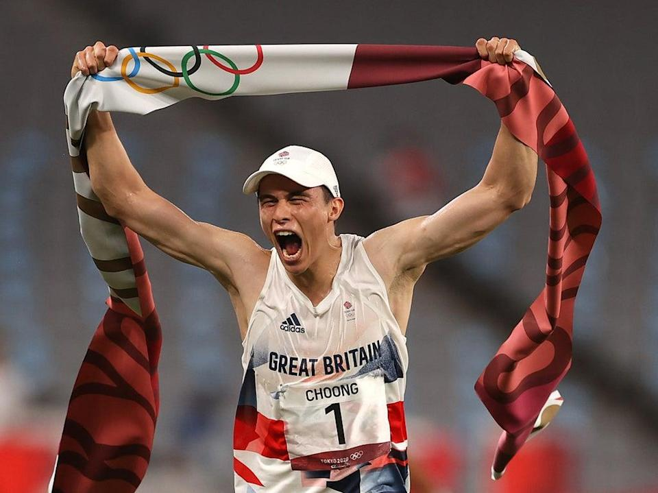 Joseph Choong celebrates after winning the laser run and Olympic gold (Getty Images)