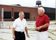 Gerald Poor (L) talks to long time friend and former co-worker Larry Terrell in front of the now shuttered BorgWarner factory in Muncie, Indiana, U.S., August 13, 2016. Poor worked at the factory for over 40 years. REUTERS/Chris Bergin