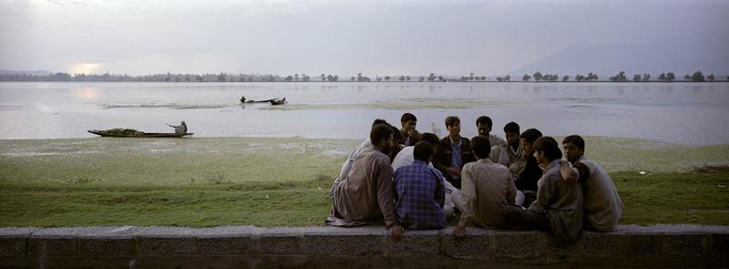 Young Kashmiris play a game of carrom on the bank of the Dal Lake in Srinagar, the capital of Jammu and Kashmir. | Prashant Panjiar—Anzenberger