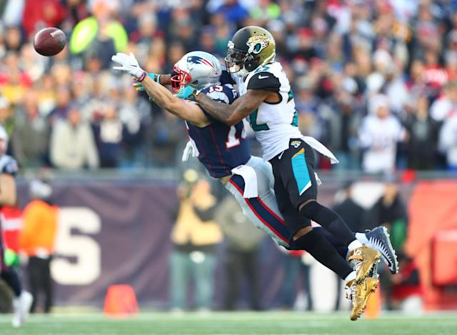 <p>Jacksonville Jaguars cornerback Aaron Colvin (22) breaks up a pass intended for New England Patriots wide receiver Chris Hogan (15) during the second quarter in the AFC Championship Game at Gillette Stadium. Mandatory Credit: Mark J. Rebilas-USA TODAY Sports </p>