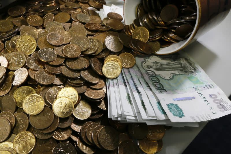 Russian 1000-rouble banknotes, 50 and 10 kopeck coins are seen at a private company's office in Krasnoyarsk