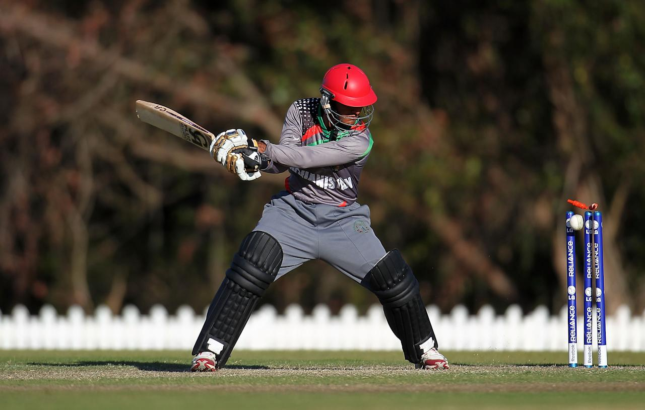 SUNSHINE COAST, AUSTRALIA - AUGUST 11:  Najibullah of Afghanistan is bowled out by Zafar Gohar of Pakistan during the ICC U19 Cricket World Cup 2012 match between Pakistan and Afghanistan at John Blanck Oval on August 11, 2012 in Sunshine Coast, Australia.  (Photo by Graham Denholm-ICC/Getty Images)