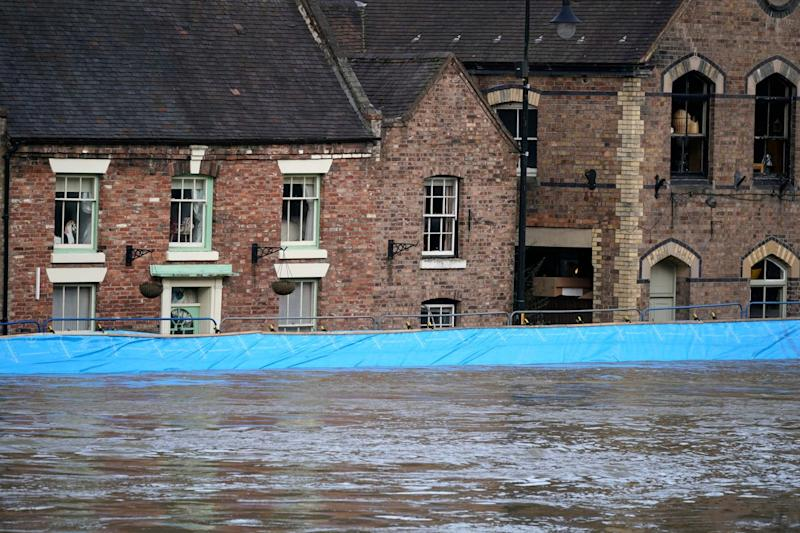 Buildings are seen behind temporary flood barriers in Ironbridge (Getty Images)