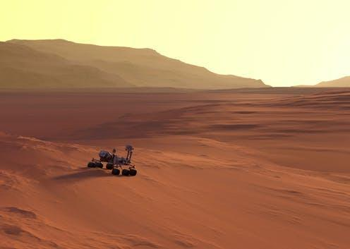 """<span class=""""caption"""">In the future, robots we've programmed may evolve and multiply on distant planets.</span> <span class=""""attribution""""><a class=""""link rapid-noclick-resp"""" href=""""https://www.shutterstock.com/image-illustration/curiosity-rover-on-mars-surface-sunset-1561750651"""" rel=""""nofollow noopener"""" target=""""_blank"""" data-ylk=""""slk:SquareMotion/Shutterstock"""">SquareMotion/Shutterstock</a></span>"""
