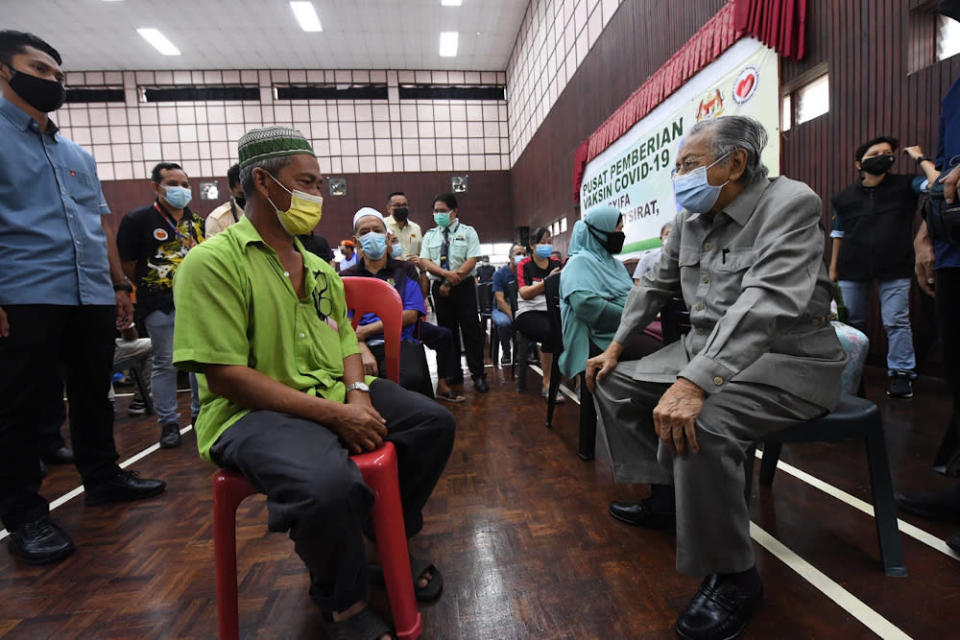Former Prime Minister Tun Mahathir Mohamad having a light moment with the society during his survey at the Assyifa Padang Mat Sirat Hall in Langkawi June 23, 2021. — Bernama pic