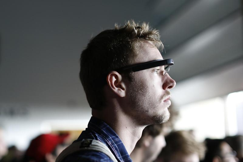 An attendee wears a Google Glass during the Google I/O Developers Conference in San Francisco, California, on June 25, 2014 (AFP Photo/Stephen Lam)