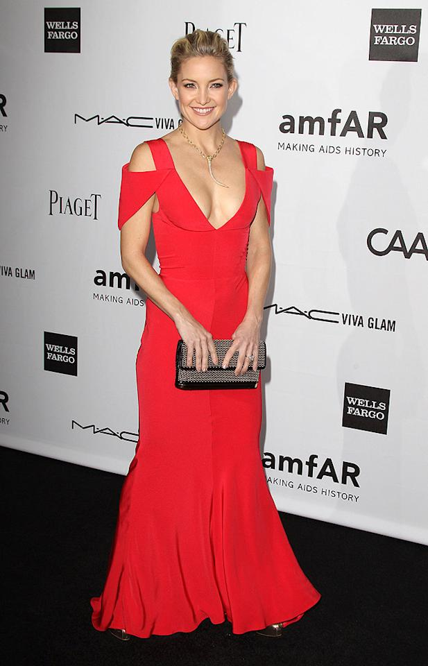 Not only is Kate Hudson one of this week's most fashionable females, she also happens to be one of the year's best-dressed beauties thanks to the gorgeous, plunging Prabal Gurung gown she donned for the 3rd annual amfAR Inspiration Gala. Perfectly complementing Kate's fiery frock were a simple updo, studded bag, and fierce gold necklace. (10/11/2012) Kendall and Kylie Jenner to launch clothing line