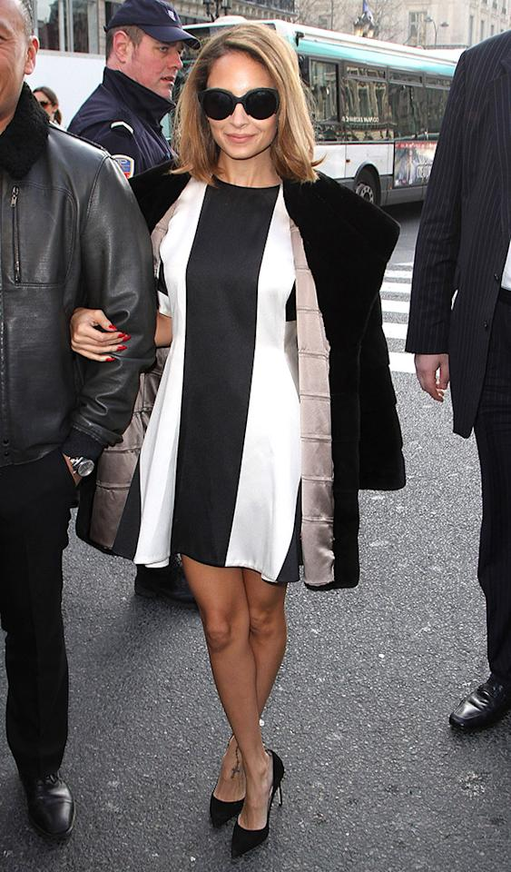 "Keeping on trend in black-and-white was Nicole Richie, who donned a striped mini, stylish shades, and blood-red nails to the highly anticipated Stella McCartney presentation on Monday morning. Dumping ex-BFF Paris Hilton a few years ago has certainly paid off for the fashionable ""Fashion Star"" judge. (3/4/2013)"
