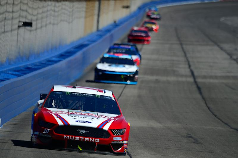 FONTANA, CA - MARCH 17: Aric Almirola, driver of the #10 Farmer John Ford, leads a pack of cars during the Monster Energy NASCAR Cup Series Auto Club 400 at Auto Club Speedway on March 17, 2019 in Fontana, California. (Photo by Robert Laberge/Getty Images)