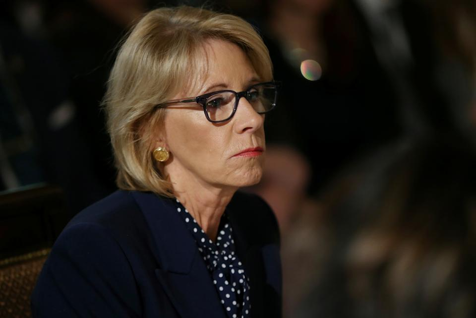 Then-Ed Sec. Betsy DeVos participates in an interagency working group to discuss youth programs hosted by Melania Trump at the White House March 18, 2019. (REUTERS/Leah Millis)