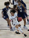 South Carolina guard Zia Cooke (1) drives around Georgia Tech guard Kierra Fletcher (41) during the first half of a college basketball game in the Sweet Sixteen round of the women's NCAA tournament at the Alamodome in San Antonio, Sunday, March 28, 2021. (AP Photo/Eric Gay)