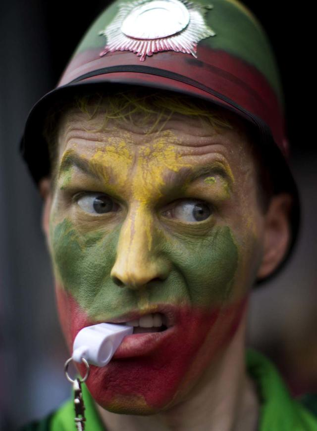A supporter of Lithuania reacts during the team's basketball game against Nigeria at the 2012 Summer Olympics on Tuesday, July 31, 2012, in London. (AP Photo/Emilio Morenatti)