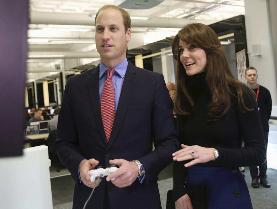 Prince William and Catherine, the Duke and Duchess of Cambridge, also known as the Earl and Countess of Strathearn, visit Abertay University in Dundee, Scotland, October 23, 2015.  William and his wife Catherine, known as Kate, on Friday began a series of official visits in Scotland. The parents of two are in Dundee all day to highlight mental health issues affecting young people and their families. In Scotland, the Duke and Duchess of Cambridge are known as the Earl and Countess of Strathearn. REUTERS/David Cheskin/Pool      TPX IMAGES OF THE DAY
