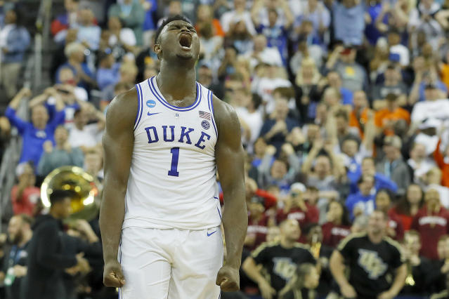 <p>Zion Williamson #1 of the Duke Blue Devils celebrates with his teammates after defeating the UCF Knights in the second round game of the 2019 NCAA Men's Basketball Tournament at Colonial Life Arena on March 24, 2019 in Columbia, South Carolina. (Photo by Kevin C. Cox/Getty Images) </p>