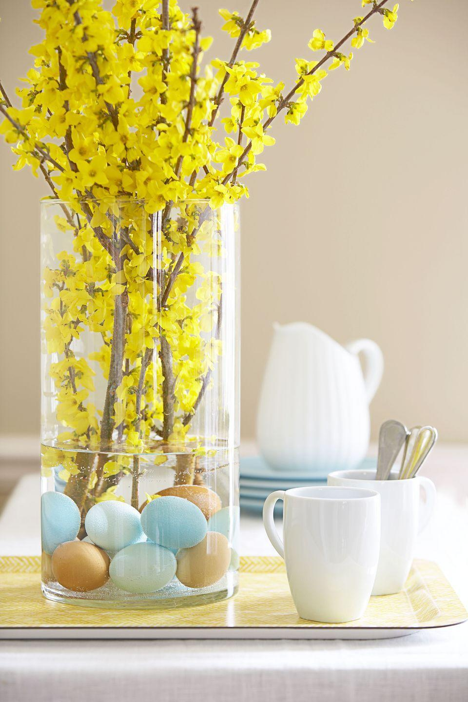 <p>Anchor brilliant forsythia with subtly hued eggs. Carefully place a dozen brown, white, and dyed ones (rinse them well first) into a vase, add water, and insert branches. </p>