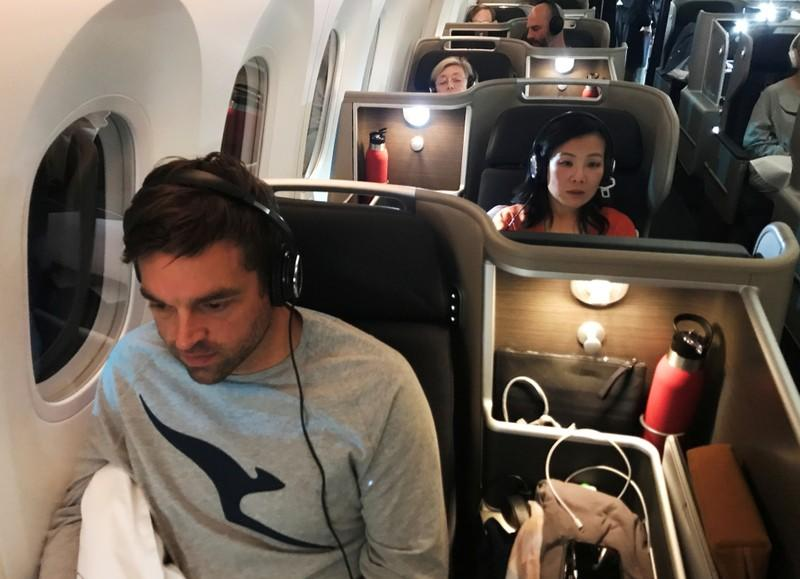 Passengers are seen on board Qantas flight QF7879, flying direct from London to Sydney