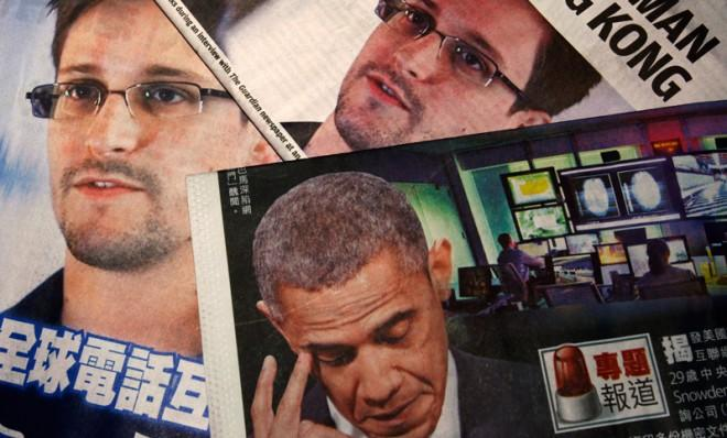 Edward Snowden and President Obama, as seen on the front pages of local newspapers in Hong Kong.