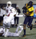 California's Makai Polk, right, evades the tackle of Washington State's Marcus Strong (4) on his touchdown run in the second half of an NCAA college football game Saturday, Nov. 9, 2019, in Berkeley, Calif. (AP Photo/Ben Margot)