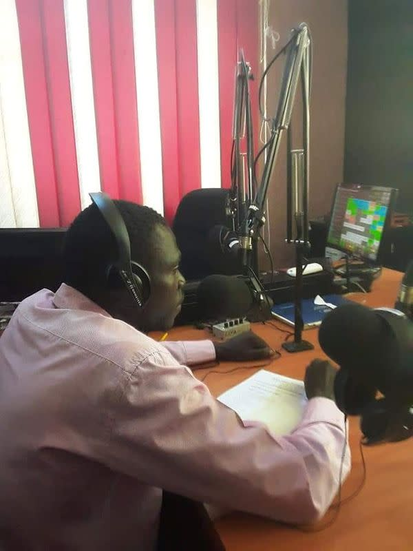 Louis Lakor attends a live broadcast about former child soldiers and child mothers in Gulu