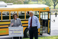 Sen. Catherine Cortez Masto, D-Nev., left, speaks alongside Sen. Tom Carper, D-Del., at a news conference to advocate for additional investments in zero-emission school buses on Capitol Hill in Washington, Tuesday, Sept. 14, 2021. (AP Photo/Patrick Semansky)