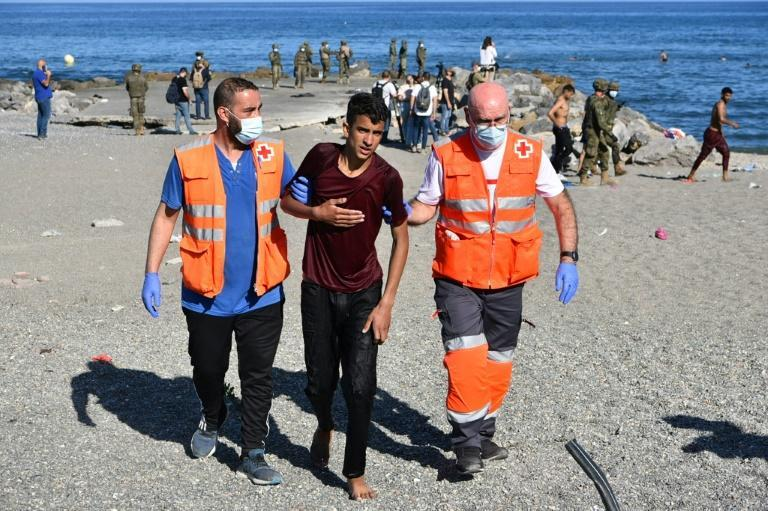 Red Cross workers were on hand Tuesday to help the migrants
