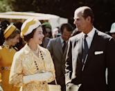 <p>Queen Elizabeth and Prince Philip in New Zealand together during their Commonwealth tour in 1974. Their daughter, Princess Anne, and her husband Mark Phillips follow behind them. </p>