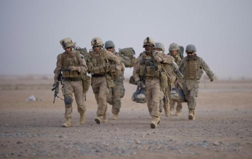 US troops have started leaving one base in Afghanistan's Helmand province -- where Marines from the 2nd Battalion, 8th Marine Regiment of the 2nd Marine Expeditionary Brigade are pictured walking towards helicopter transport in 2009