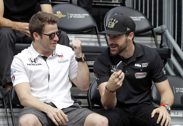 FILE - In this May 28, 2016, file photo, James Hinchcliffe, right, of Canada, talks with Marco Andretti during the drivers meeting for the Indianapolis 500 auto race at Indianapolis Motor Speedway in Indianapolis. Hinchcliffe will return to Andretti Autosport for three races this season, including the Indianapolis 500. (AP Photo/Darron Cummings, File)
