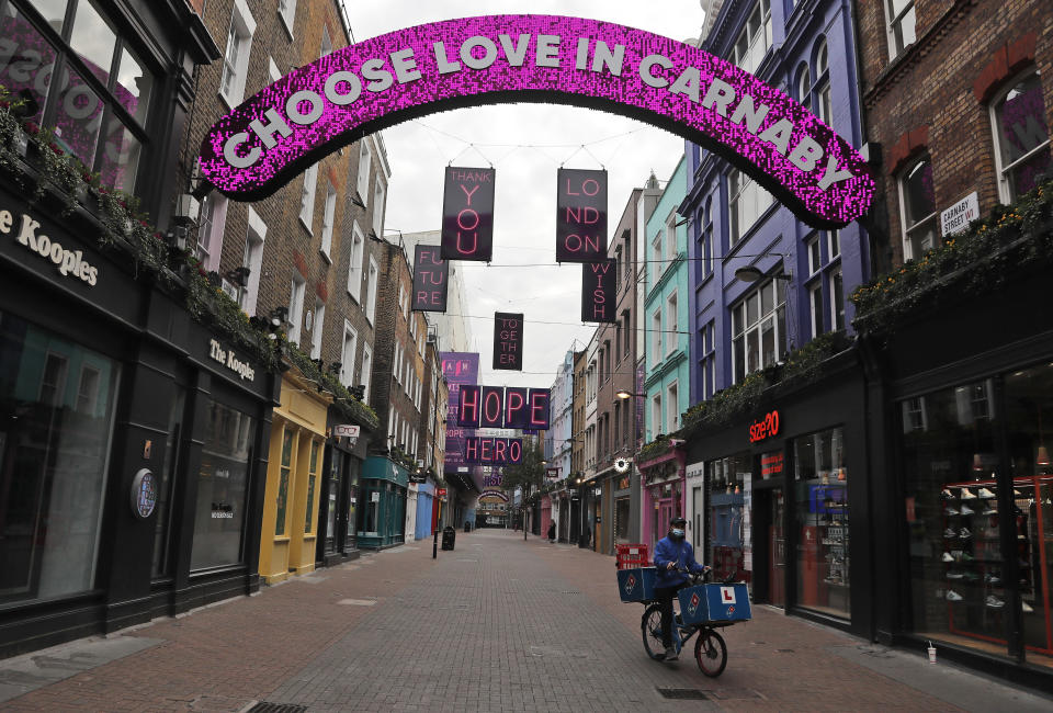 A nearly empty Carnaby Street in London, Friday, Nov. 6, 2020. Britain's lockdown started Thursday, shuttering restaurants, hairdressers and clothing stores until at least Dec. 2. (AP Photo/Frank Augstein)