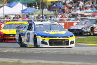 Chase Elliott (9) leads a group through a turn during a NASCAR Cup Series auto race Sunday, July 4, 2021, at Road America in Elkhart Lake, Wis. (AP Photo/Jeffrey Phelps)