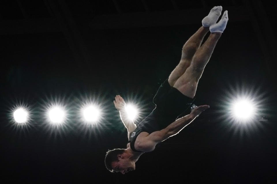 Dylan Schmidt, of New Zealand, competes in the in the men's trampoline gymnastics qualifier at the 2020 Summer Olympics, Saturday, July 31, 2021, in Tokyo. (AP Photo/Ashley Landis)