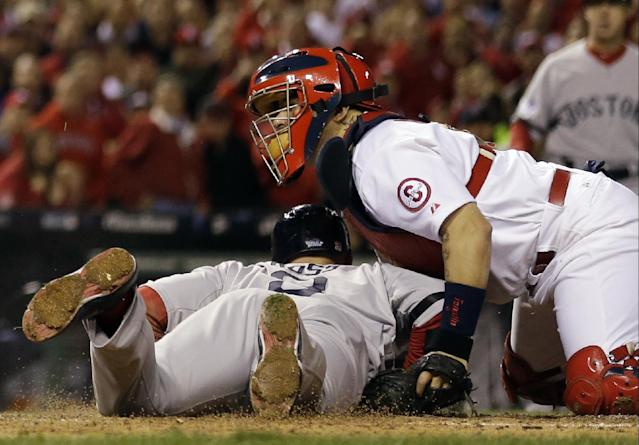 St. Louis Cardinals catcher Yadier Molina tags out Boston Red Sox's David Ross at home during the seventh inning of Game 5 of baseball's World Series Monday, Oct. 28, 2013, in St. Louis. Ross tried to score from second on a hit by Jacoby Ellsbury.(AP Photo/Jeff Roberson)