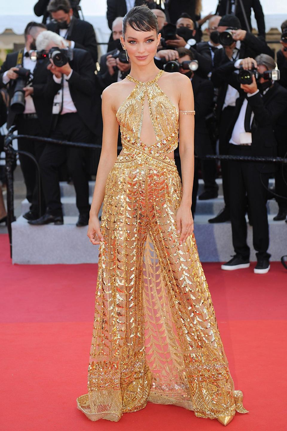 """Model Luma Grothe did a take on party dressing in a gown with an exposed back by Zuhair Murad. <span class=""""copyright"""">Photo: Stefanie Rex/picture alliance/Getty Images.</span>"""