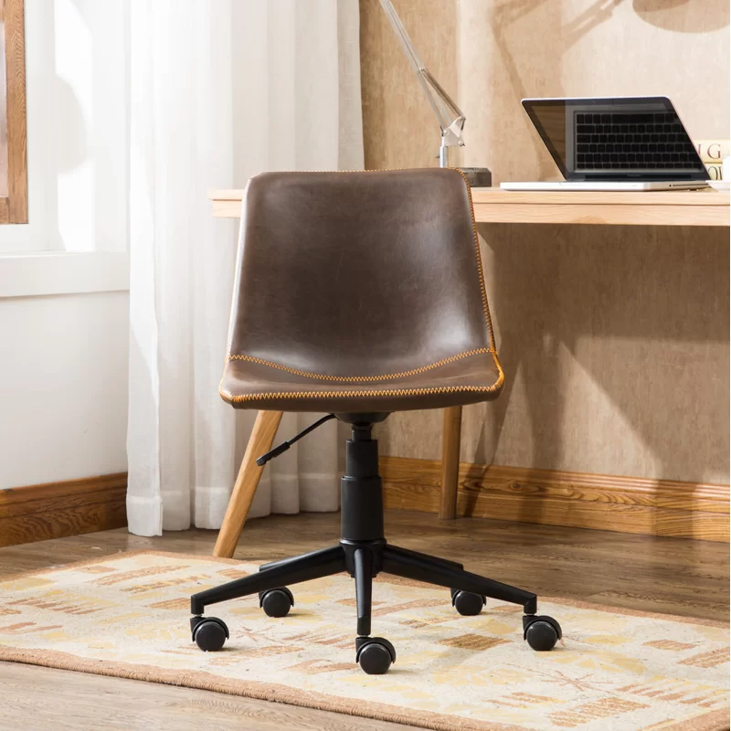 """<h3>Alina Task Chair</h3><br><strong>Best For: A Classic Design</strong><br>This sweet desk chair features a modern, yet industrial design with its sleek steel frame and faux leather upholstery.<br><br><strong>The Hype: </strong>4.6 out of 5 stars and 1,290 reviews on <a href=""""https://www.wayfair.com/furniture/pdp/grovelane-alina-air-lift-task-chair-w001353795.html"""" rel=""""nofollow noopener"""" target=""""_blank"""" data-ylk=""""slk:Wayfair"""" class=""""link rapid-noclick-resp"""">Wayfair</a><br><br><strong>Comfy Butts Say:</strong> """"I have been pleasantly surprised by how comfortable this chair is! I was worried it wouldn't be comfy since it was so reasonably priced but it's turned out to be a winner. I've spent several full days in it while working from home and it's been great. Love that it doesn't look like the typical office chair. Very stylish!""""<br><br><strong>Grovelane</strong> Alina Task Chair, $, available at <a href=""""https://go.skimresources.com/?id=30283X879131&url=https%3A%2F%2Fwww.wayfair.com%2Ffurniture%2Fpdp%2Fgrovelane-alina-task-chair-w001353795.html"""" rel=""""nofollow noopener"""" target=""""_blank"""" data-ylk=""""slk:Wayfair"""" class=""""link rapid-noclick-resp"""">Wayfair</a>"""