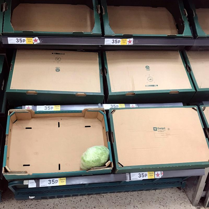 Empty shelves where lettuces are normally sold at the Portsmouth North Harbour Tesco. - PA